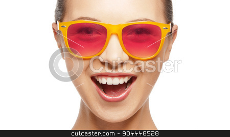 happy teenage girl in shades stock photo, happiness and people concept - portrait of happy teenage girl in shades by Syda Productions