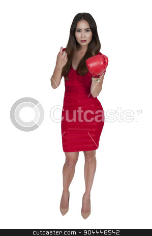 Boxing stock photo, Beautiful young woman wearing a pair of boxing gloves by Robert Byron