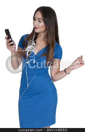 Woman with tangled ear buds stock photo, Woman using tangled ear buds to listen to her music by Robert Byron