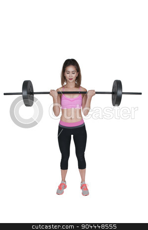 Woman Working with Weights stock photo, Beautiful young woman using weights during a workout by Robert Byron
