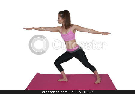 Woman Doing Yoga stock photo, Beautiful woman doing her Yoga stance exercises by Robert Byron