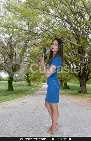Woman with Pistol stock photo, Beautiful young woman holding a loaded handgun by Robert Byron