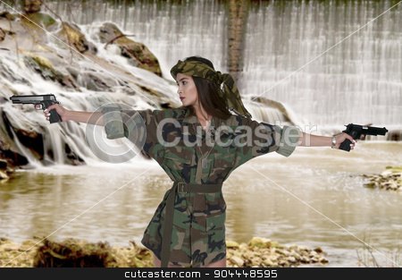 Woman Soldier stock photo, Beautiful young woman soldier with a gun by Robert Byron