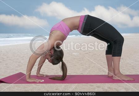 Woman Doing Yoga stock photo, Beautiful woman doing a set of Yoga exercises by Robert Byron