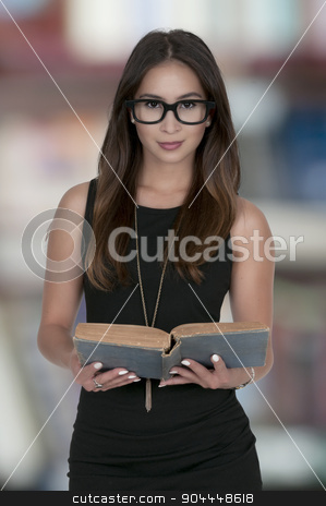 Woman Reading a Book stock photo, Beautiful young woman reading an interesting book by Robert Byron