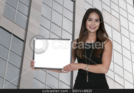 Woman Holding a Blank Sign stock photo, Beautiful young woman holding up a blank sign by Robert Byron