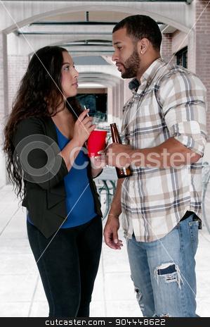Man and Woman drinking stock photo, Man and a Woman drinking alcoholic beverages by Robert Byron