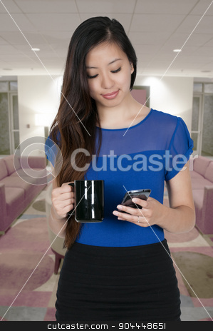 Woman on the Phone stock photo, Beautiful woman using a cell phone will holding coffee by Robert Byron