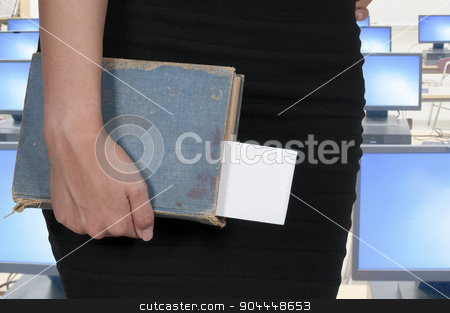 Woman holding book stock photo, Beautiful woman holding a library book by Robert Byron