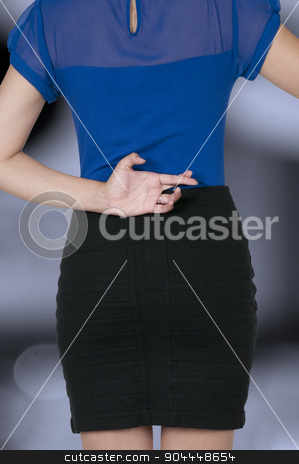 Woman with fingers crossed stock photo, Beautiful woman with her fingers crossed behind her back by Robert Byron