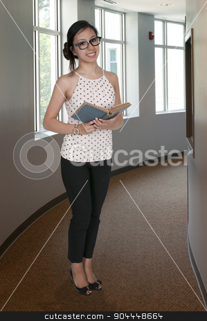 Woman Reading a Book stock photo, A beautiful young woman reading a book by Robert Byron