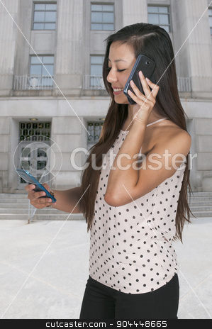 Woman on the Phone stock photo, Beautiful woman talking and multitasking while juggling multiple cell phones and conversations by Robert Byron