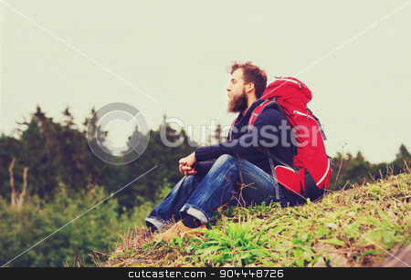 man with backpack hiking stock photo, adventure, travel, tourism, hike and people concept - man with beard and red backpack sitting on ground by Syda Productions