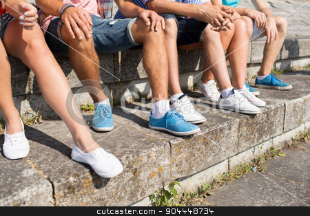 close up of friends legs sitting on city square stock photo, friendship, leisure, summer and people concept - close up of friends legs sitting on city square by Syda Productions