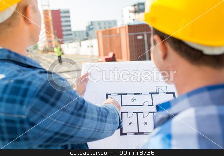 close up of builders with blueprint at building stock photo, building, construction, development, teamwork and people concept - close up of builders with blueprint at building site by Syda Productions