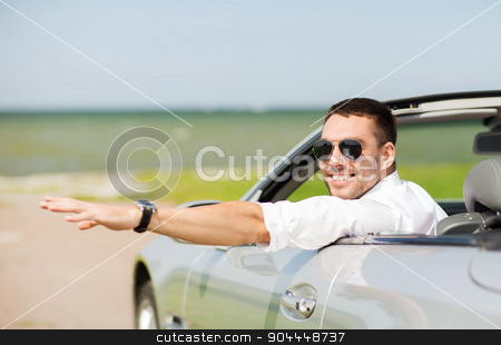 happy man driving cabriolet car and waving hand stock photo, auto business, transport, leisure and people concept - happy man driving cabriolet car and waving hand outdoors by Syda Productions