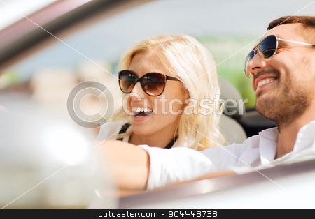 happy man and woman driving in cabriolet car stock photo, road trip, dating, leisure, couple and people concept - happy man and woman driving in cabriolet car outdoors by Syda Productions