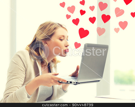 woman sending kisses with laptop computer stock photo, virtual relationships, online dating and social networking concept - woman sending kisses with laptop computer by Syda Productions