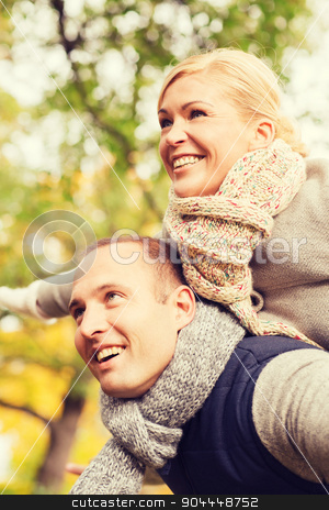 smiling couple having fun in autumn park stock photo, love, relationship, family and people concept - smiling couple having fun in autumn park by Syda Productions