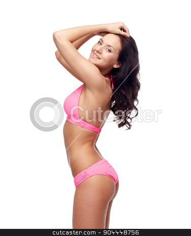 happy young woman in pink bikini swimsuit stock photo, people, fashion, swimwear, summer beach and beauty concept - happy young woman posing in pink bikini swimsuit by Syda Productions