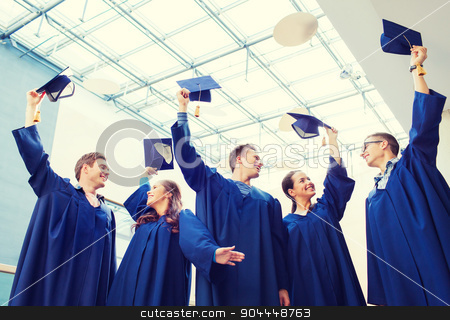group of smiling students in mortarboards stock photo, education, graduation and people concept - group of smiling students in gowns waving mortarboards outdoors by Syda Productions