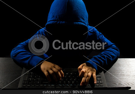 Faceless Hacker using computer stock photo, Faceless hacker with laptop in black isolated background. by Tan Kian Khoon