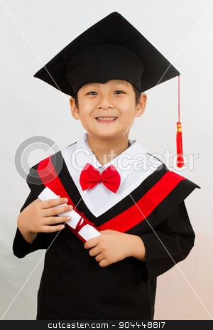 Chinese Graduation Boy  stock photo, Chinese little boy graduation in white backround studio shot. by Tan Kian Khoon