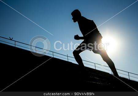 Runner stock photo, Runner training on a stadium stairs by Roland Valentin Raicu