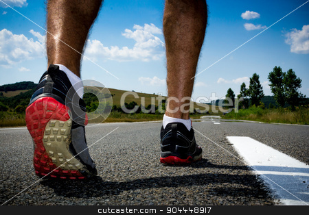 Runner stock photo, Runner getting ready for training o a road in the middle of nowhere by Roland Valentin Raicu