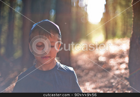 In the forest stock photo, Portrait of young boy sitting in forest. Shallow depth of field. by olinchuk
