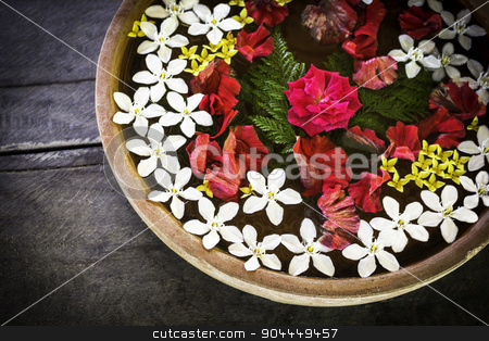 Spa therapy with flowers stock photo, Spa therapy with flowers on  water in bowl   and wooden background by manusy
