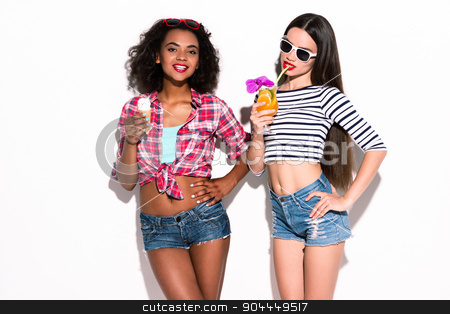 Funky couple. Creative concept of beautiful sexy girls.  stock photo, Colorful picture of beautiful slim young women on white background. Girls smiling and holding cocktail and ice cream by Dmytro Sidelnikov