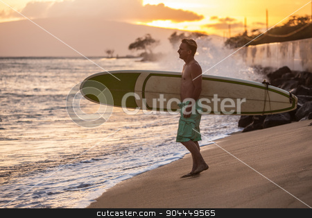 Surfer On Beach at Sunset stock photo, Sunset at beach with surfer walking toward the water by Scott Griessel