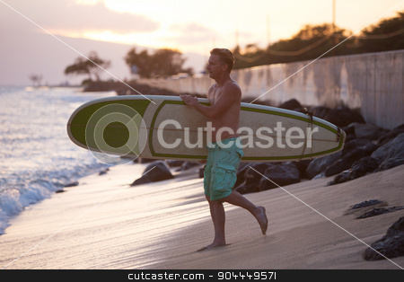 Walking Down Beach to Surf stock photo, Single athletic man carrying surfboard along waterfront by Scott Griessel