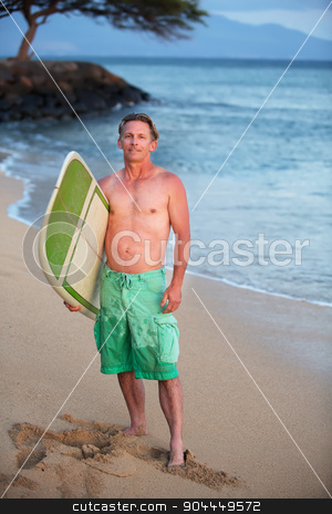 Confident Surfer at Shoreline stock photo, Single adult Caucasian male outdoors with surfboard at shoreline by Scott Griessel