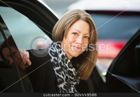 Optimistic Female In Car stock photo, Optimistic executive business woman sitting inside car by Scott Griessel