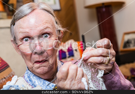 Surprised Woman Sewing stock photo, Elderly woman crocheting while looking at camera by Scott Griessel