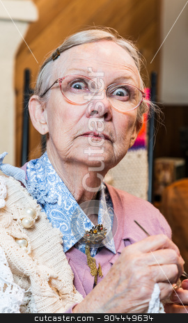 Startled Old Woman with Crochet stock photo, Startled old woman with crochet in livingroom by Scott Griessel