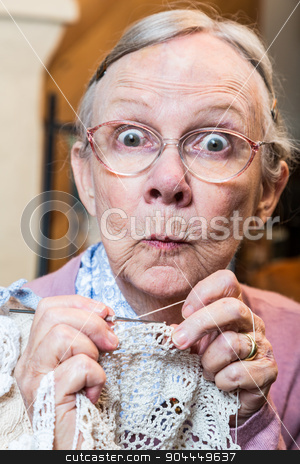 Funny Elderly Woman with Crochet stock photo, Elder woman with crochet and funny facial expression by Scott Griessel