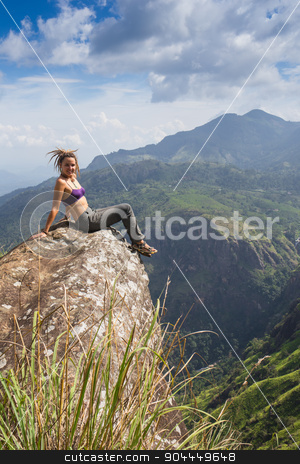 Happy celebrating winning success woman stock photo, Happy celebrating winning success woman at sunset or sunrise standing elated with arms raised up above her head in celebration of having reached mountain top summit goal during hiking travel trek. by Vassiliy Kochetkov