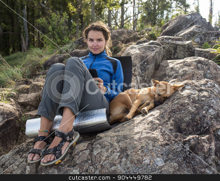 Portrait of a woman with her beautiful dog stock photo, Portrait of a woman with her beautiful dog lying outdoors by Vassiliy Kochetkov