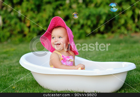 little girl bathes in a bath with soap bubbles stock photo, little girl bathes in a bath with soap bubbles. by timonko