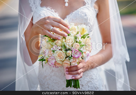 Bride holding beautiful wedding bouquet stock photo, Bride holding beautiful wedding bouquet. by timonko