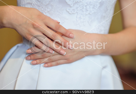 hands of a bride with a wedding manicure stock photo, hands of a bride with a wedding manicure. by timonko