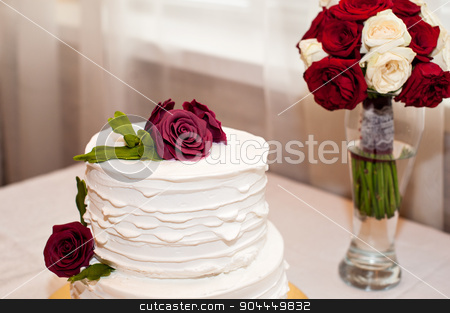 beautiful white cake and red bouquet stock photo, beautiful white cake and red bouquet on the table by timonko