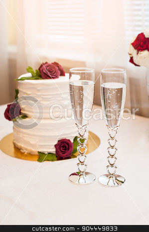 beautiful white cake with red roses and two glasses with champagne stock photo, beautiful white cake with red roses and two glasses with champagne. by timonko