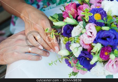 Bride holding beautiful wedding bouquet stock photo, Bride holding beautiful wedding bouquet. by timonko