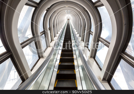 escalators successful concept stock photo, perspective escalators stairway inside contemporary blue glass business centre, concept of successful career elevation by Vichaya Kiatying-Angsulee