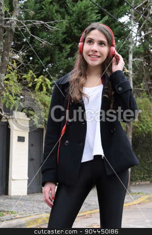 Latin young woman with headphones. stock photo, Latin young woman listening to music with red headphones. by nicolas menijes