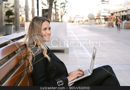 Business woman working on a laptop. stock photo, Succesful business woman working on a laptop outside her office. by nicolas menijes